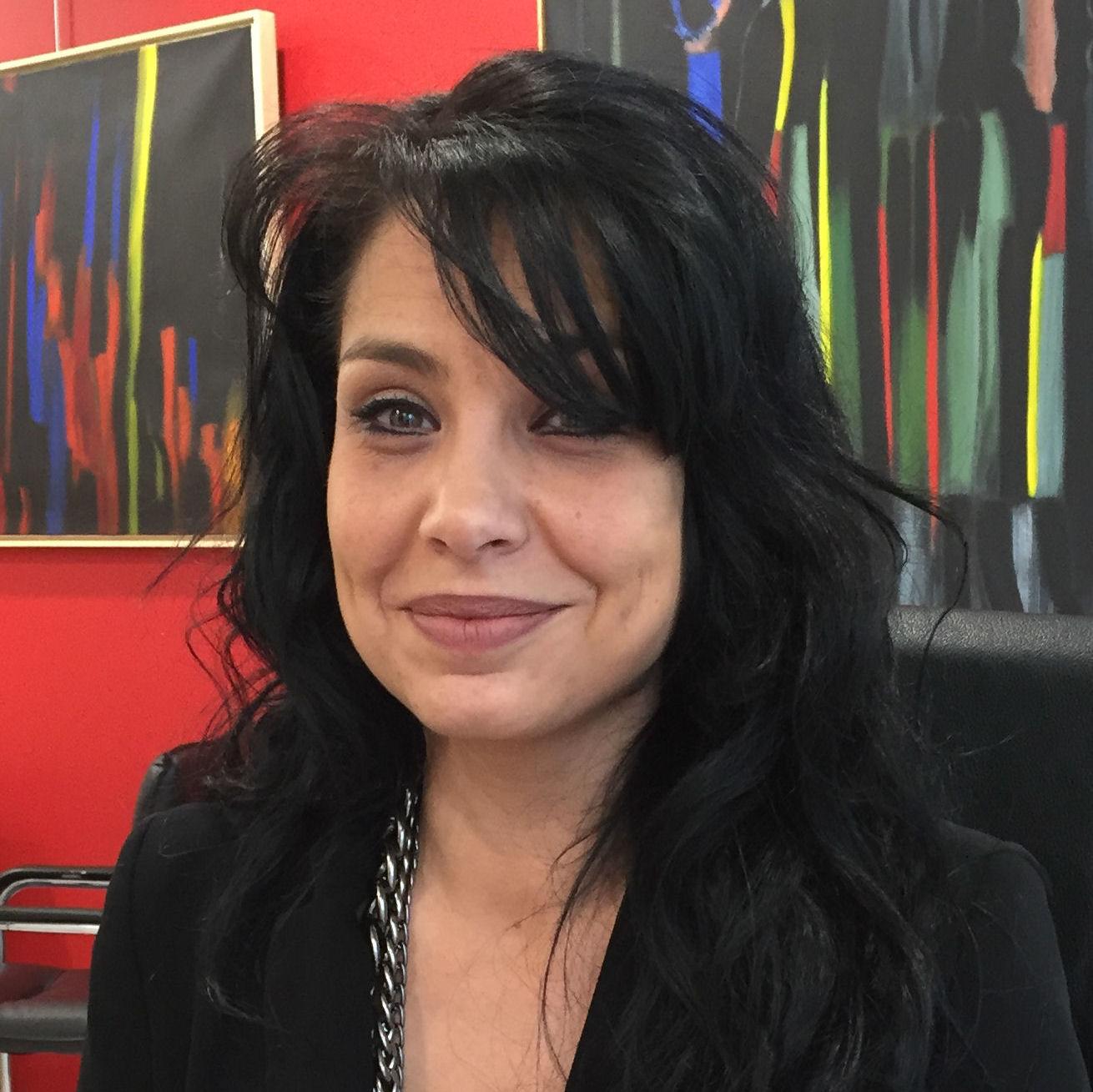 Audrey de l'équipe des audioprothésistes du centre auditif Minitone à Nîmes dans le Gard.